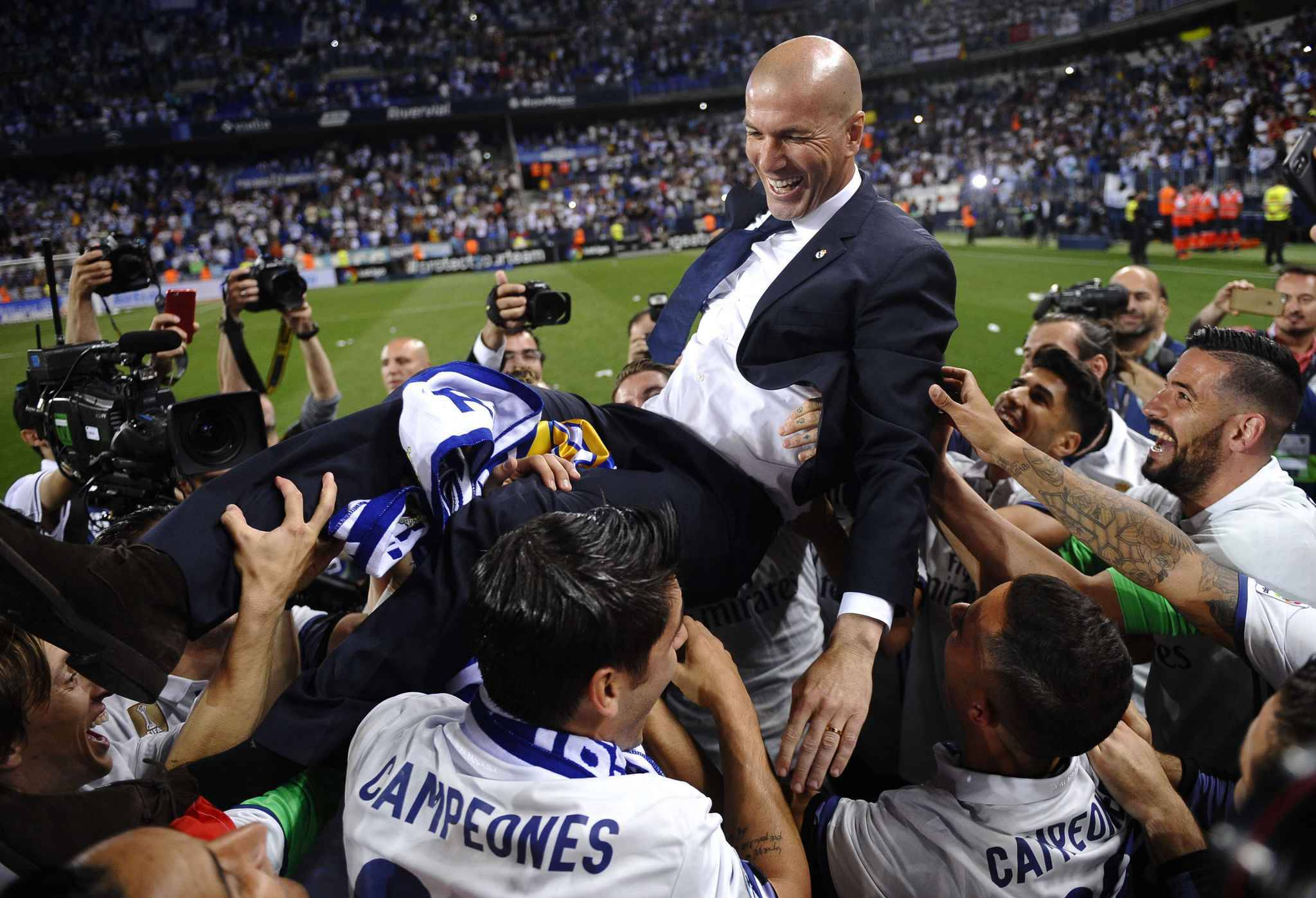 Real Madrid's head coach Zinedine Zidane is thrown into the air by his players after winning a Spanish La Liga soccer match between Malaga and Real Madrid in Malaga, Spain, Sunday, May 21, 2017. Real Madrid wins the Spanish league for the first time in five years, avoiding its biggest title drought since the 1980s. (AP Photo/Daniel Tejedor)/EM158/17141728598885/1705212222