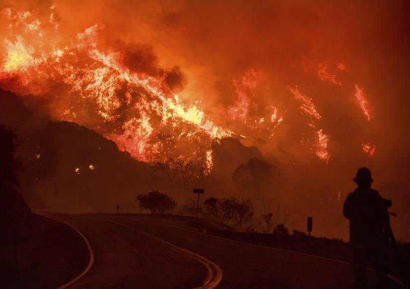 The Thomas fire burns through Los Padres National Forest near Ojai, Calif., on Friday, Dec. 8, 2017.