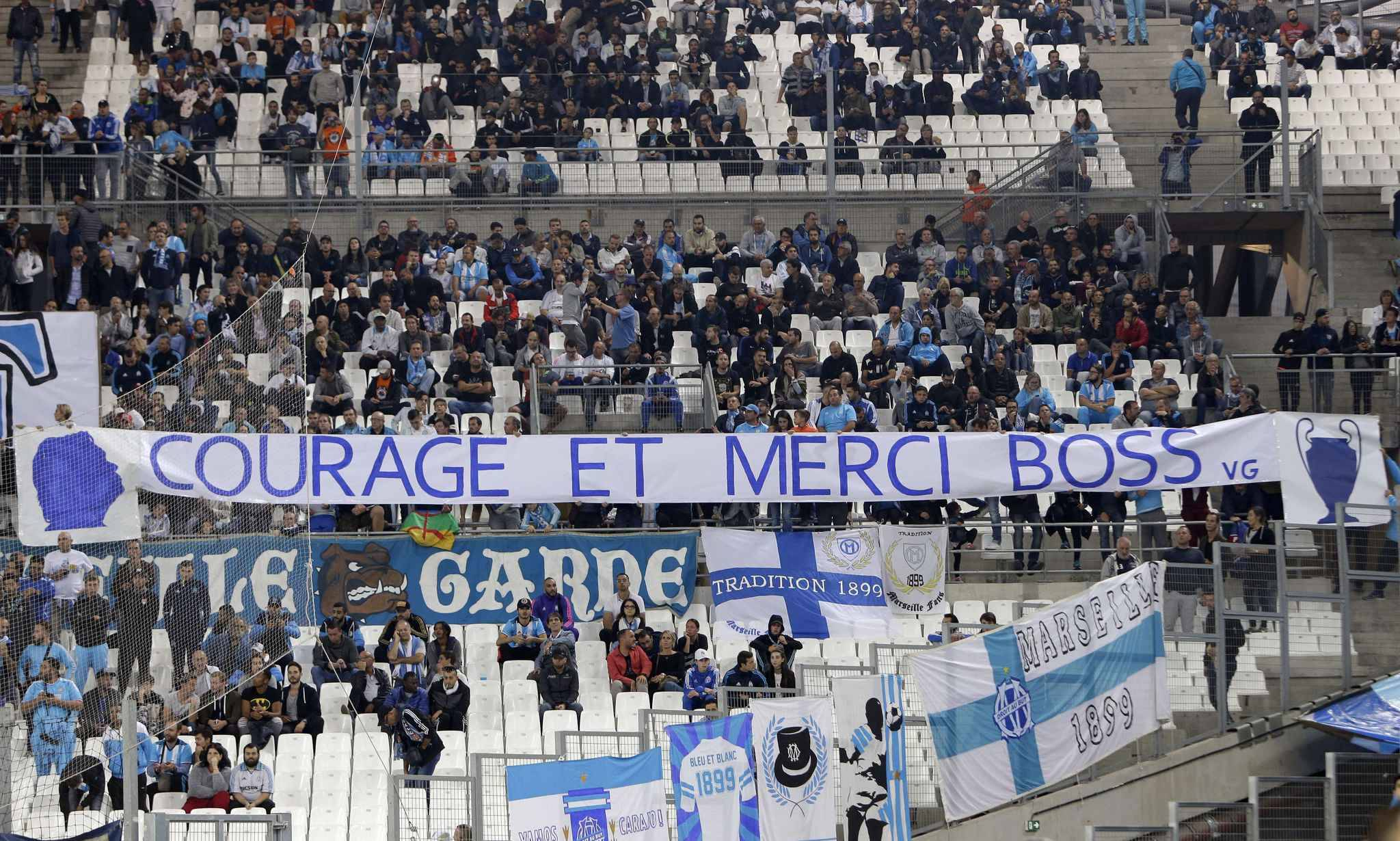 """South side supporters displayed banner reading """"Courage and thank you"""", in support for the former president Bernard Tapie who underwent a surgical operation, before the League One soccer match between Marseille and Toulouse, at the Velodrome stadium, in Marseille, southern France, Sunday, Sept. 24, 2017."""