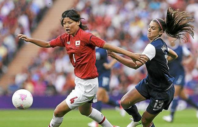 Japan's Saki Kumagai, left, and United States' Alex Morgan vie for the ball during the women's soccer gold medal match at the 2012 Summer Olympics, Thursday, Aug. 9, 2012, in London. (AP Photo/Ben Curtis)/OSOC443/726333595076/1208092125