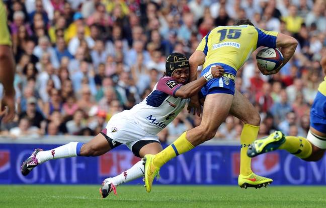 http://img.20mn.fr/BIP_TE7xS8WLUPT_IEhfCg/648x415_bordeaux-s-south-african-scrum-half-heini-adams-l-tackles-clermont-s-french-fullback-jean-marcellin.jpg