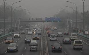 """Cars travel on the second ring road as pollution reaches what the US Embassy monitoring station says are """"Hazardous"""" levels in Beijing on December 5, 2011. Officially, Beijing's air quality is improving but in recent weeks patients with respiratory problems have flooded hospitals, highways have closed and hundreds of flights have been grounded by thick smog. Concerns are being fuelled in part by data gathered by the US embassy in Beijing, which produces its own pollution readings using a different gauge to Chinese authorities and broadcasts them online and on Twitter. AFP PHOTO/Mark RALSTON"""
