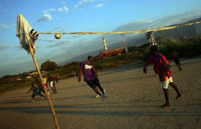 A group of youths play soccer on a small field beside the sea in the Port-au-Prince slum of Cite Soleil on April 18, 2011. They meet every evening to play, to take advantage of good weather before the rains come, they said. AFP PHOTO/Hector Retamal