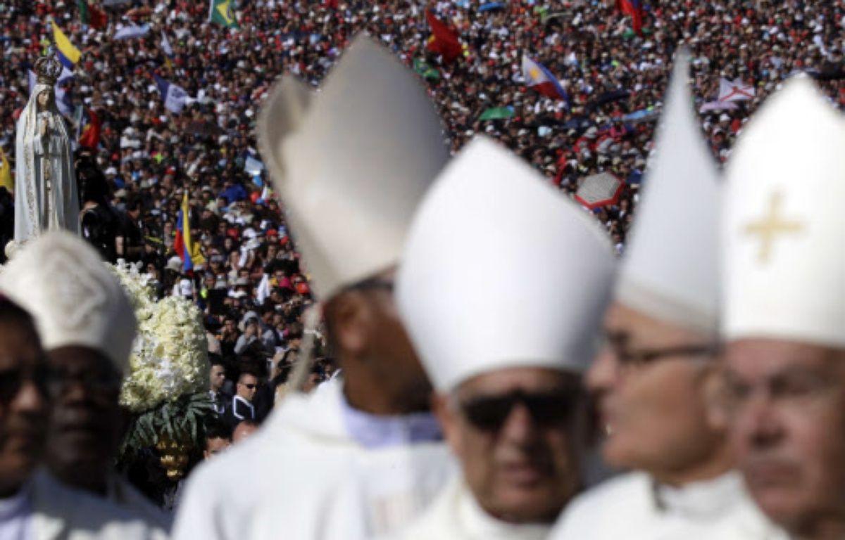 Francisco Marto et sa soeur Jacinta, deux petits bergers qui ont témoigné d'apparitions de la Vierge voici cent ans, ont été déclarés saints samedi par le pape François. – Alessandra Tarantino