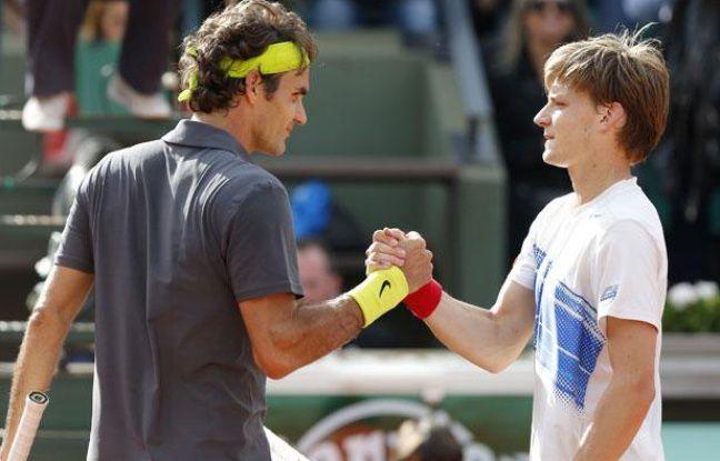 Roger Federer et David Goffin, le 3 juin 2012, sur le court Suzanne-Lenglen, à Roland-Garros.