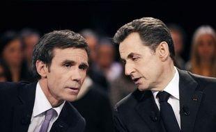 """L'émission """"Des paroles et des actes"""" avec Nicolas Sarkozy sur France 2 a réuni mardi soir 5,6 millions de téléspectateurs, juste un peu plus que la même émission avec François Hollande en janvier, qui avait réuni 5,5 millions de personnes, a indiqué mercredi l'institut Médiamétrie."""