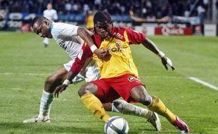 André Ayew (ici à la lutte avec Aurier) aura tout tenté contre Lens.