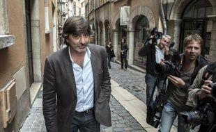 L'ancien policier chef de l'antigang à Lyon, Michel Neyret dans une des rues de la ville, le 19 septembre 2014 après avoir été entendu au tribunal