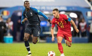 Pogba face à Hazard lors de France-Belgique en demi-finale de la Coupe du monde 2018 en Russie.