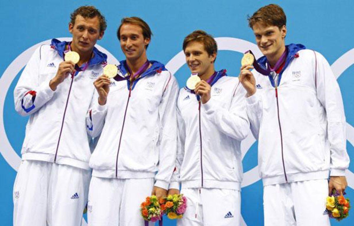 Les relayeurs français du 4X100m, sur le podium des Jeux Olympiques de Londres, le 29 juillet 2012. – REUTERS