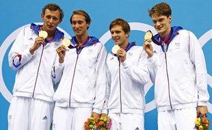 Les relayeurs français du 4X100m, sur le podium des Jeux Olympiques de Londres, le 29 juillet 2012.