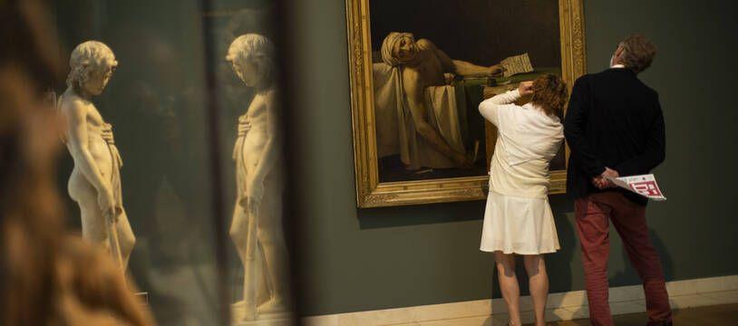 Des visiteurs aux Musées Royaux des Beaux-Arts de Belgique, à Bruxelles.