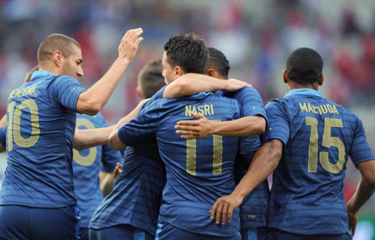 Les Français Benzema, Nasri et Malouda, le 31 mai 2012 contre la Serbie, àReims. – AFP PHOTO / FRANCK FIFE