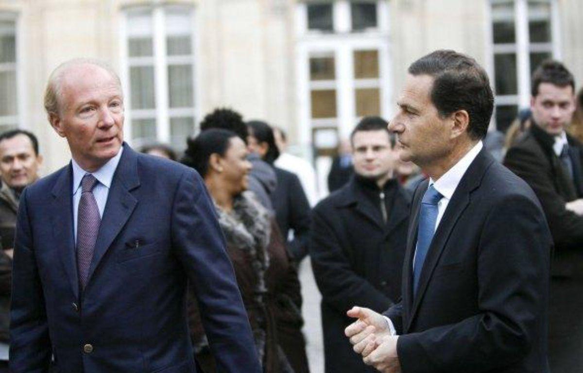 Eric Besson et Brice Hortefeux, lors du Conseil national de l'UMP, le 24 janvier 2009. – FACELLY / SIPA