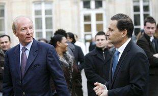 Eric Besson et Brice Hortefeux, lors du Conseil national de l'UMP, le 24 janvier 2009.