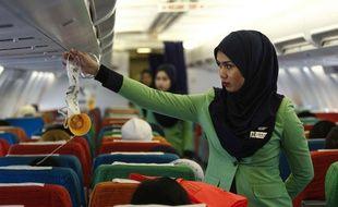Des hôtesses de Rayani Air, première compagnie aérienne malaisienne respectant les préceptes de la loi islamique, le 22 décembre 2015, en Malaysie.