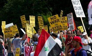 Des manifestants hostiles à une possible attaque américaine contre la Syrie, le 31 août 2013 devant la Maison Blanche à Washington