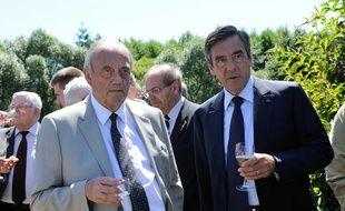 Le maire d'Epinal  Michel Heinrich, en compagnie de François Fillon, à Etival-Clairefontaine, en 2012.