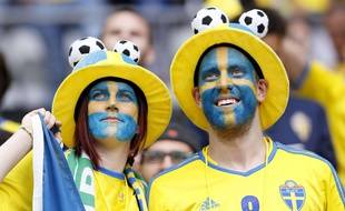 Sweden team supporters, their faces painted in the colors of the national flag, smile prior to the Euro 2016 Group E soccer match between Ireland and Sweden at the Stade de France in Saint-Denis, north of Paris, France, Monday, June 13, 2016. (AP Photo/Christophe Ena)/FP110/556612189780/1606131756