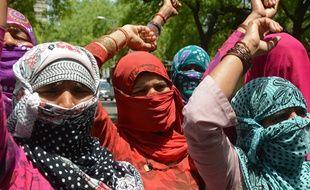 Des Indiennes manifestent contre les violences faites aux femmes à New Delhi, le 22 avril 2014.