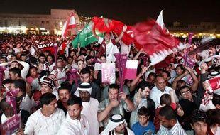 Les Qatari fêtent la grande nouvelle dans un quartier de Doha, le 2 décembre 2010