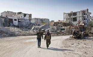 Des combattants kurdes à Kobané le 19 novembre 2014.
