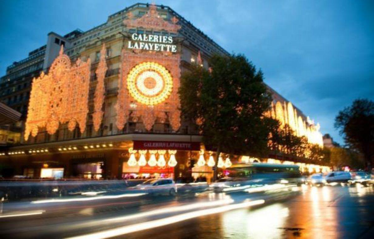 Le groupe Galeries Lafayette, qui va céder les 50% de Monoprix qu'il détenait pour 1,175 milliard d'euros, veut accroître ses parts de marchés dans le prêt-à-porter, la parfumerie, les montres, la bijouterie et l'e-commerce, selon son PDG, Philippe Houzé. – Martin Bureau afp.com