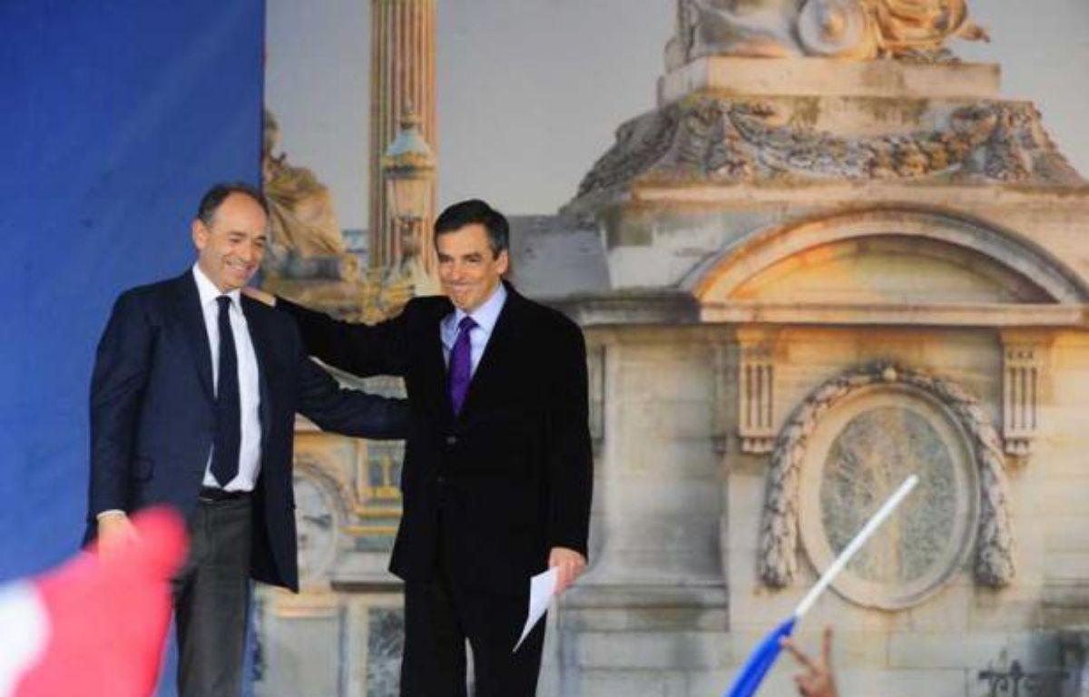 Jean-FrançoisCopé et FrançoisFillon, le 15 avril 2012, avant le meeting de Nicolas Sarkozy sur la place de la Concorde, à Paris. – ALFRED/SIPA