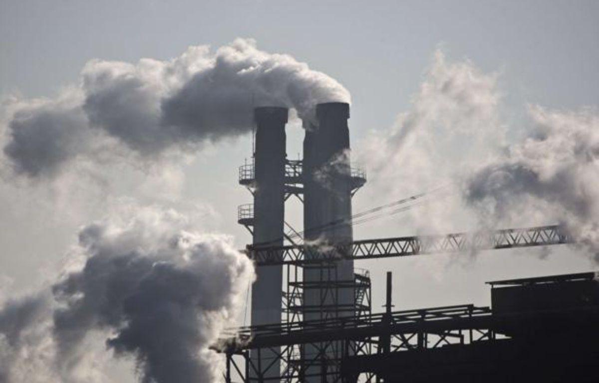 Fumée d'une cheminée d'usine, à Pékin, en Chine. – Alexander F. Yuan/AP/SIPA