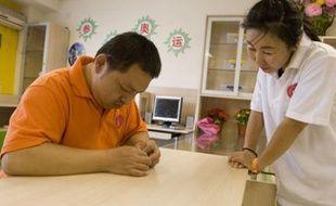 Au centre de Dongsi, qui accueille des personnes handicapées, à Pékin.