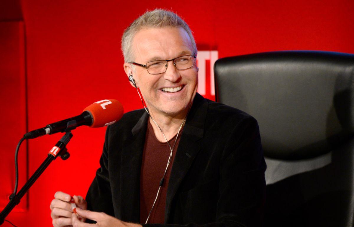 Laurent Ruquier au micro de RTL en 2014. – BERTRAND GUAY / AFP