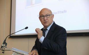 Le ministre des Finances Michel Sapin lors de la remise d'un rapport de Tracfin à Paris, le 11 juillet 2014