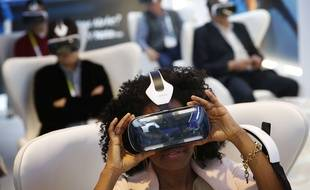 Yasmin Moorman looks into the Galaxy Gear VR headset at the Samsung booth during the International CES, Tuesday, Jan. 6, 2015, in Las Vegas. (AP Photo/John Locher)/NVJL122/579514850490/1501070045