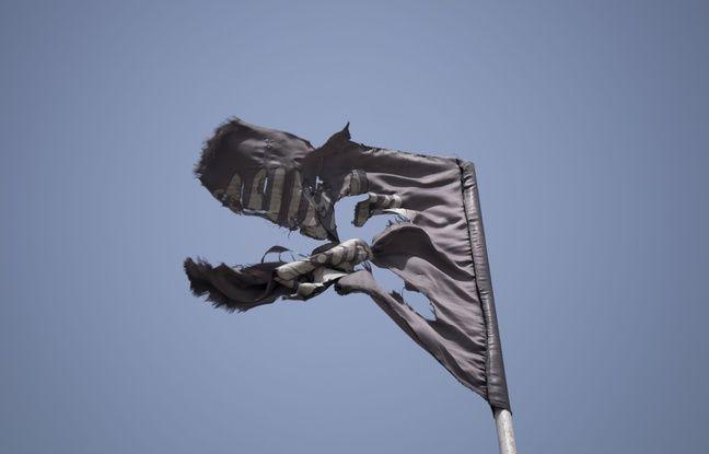 648x415 drapeau dechire etat islamique illustration