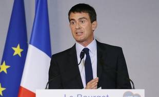 French Prime Minister Manuel Valls gives a speech during a visit at the World Nuclear Exhibition (WNE), on October 15, 2014 in Le Bourget, outside Paris. AFP PHOTO / PATRICK KOVARIK