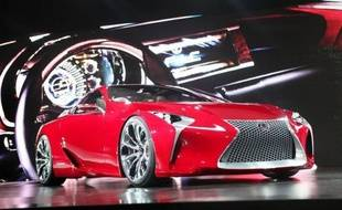 """Les voitures """"vertes"""", hybrides ou électriques, suscitent optimisme chez les uns et scepticisme chez d'autres au salon automobile de Detroit, alors que leurs ventes piétinent mais que les opportunités de vente à moyen terme sont réelles."""