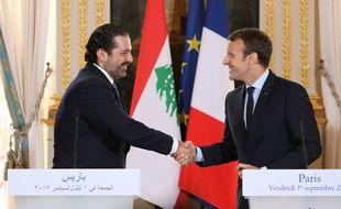 Le 1 septembre 2017, Emmanuel Macron et Saad Hariri à Paris. AFP PHOTO / Ludovic MARIN