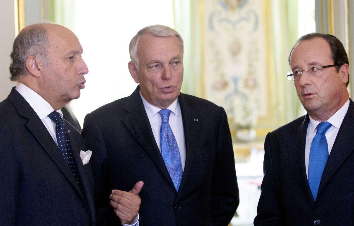 Laurent Fabius, Jean-Marc Ayrault et François Hollande le 11 février 2016 à Paris. – Kenzo Tribouillard/AP/SIPA