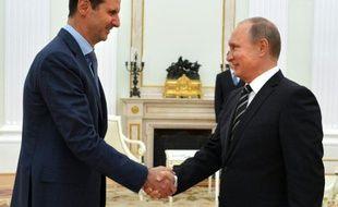 Le président syrien, Bachar al-Assad (g), et son homologue russe, Vladimir Poutine, à Moscou, le 21 octobre 2015