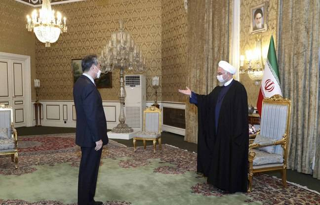 648x415 president iranien hassan rohani accueillant ministre affaires etrangeres chinois wang yi