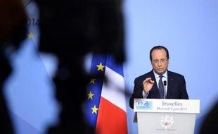Le président François Hollande donne une conférence de presse à Bruxelles, le 4 juin 2014