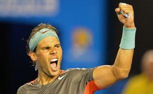Rafael Nadal célèbre sa victoire sur Roger Federer en demi-finale de l'Open d'Australie.
