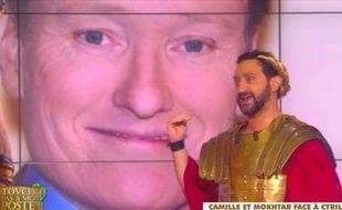 Cyril Hanouna devant une photo de Conan O'Brien, mardi 24 février 2015, dans Touche pas à mon poste.