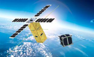Le nanosatellite en cours de conception au Centre spatial universitaire de Montpellier (à droite)
