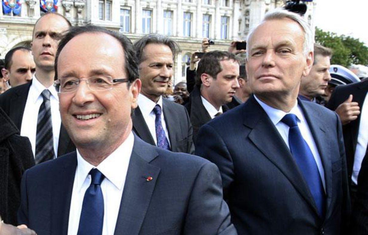 François Hollande et Jean-Marc Ayrault, le 15 mai 2012 à Paris. – P. ROSSIGNOL / AFP