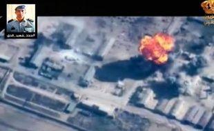 Capture d'écran de la TV jordanienne montrant de la fumée s'élevant d'un bâtiment le 5 février 2015 après un raid jordanien contre le groupe Etat islamique