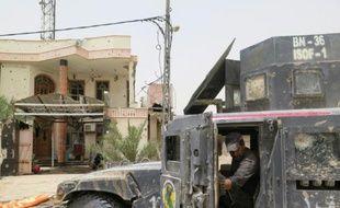 Un véhicule des forces antiterroristes garées à Falloujah pendant une opération pour regagner la ville au groupe EI le 16 juin 2016
