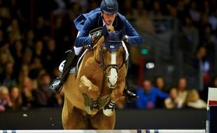 German rider Daniel Deusser competes in the Longines FEI World Cup Jumping event on February 9, 2019 at the Parc des expositions, in Bordeaux, southwestern France. (Photo by NICOLAS TUCAT / AFP)