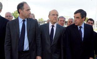 Jean-François Copé, Alain Juppé et François Fillon (de gauche à droite) à Bordeaux, le 3 mai 2012.