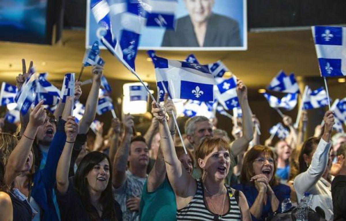 Les indépendantistes du Parti québécois (PQ) ont remporté mardi les élections législatives et reprendront le pouvoir à la tête de la province canadienne francophone après une éclipse de neuf ans, selon les projections de la chaîne privée de télévision TVA et de Radio-Canada. – Rogerio Barbosa afp.com